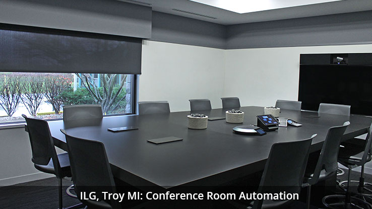 Large conference room with black table and chairs
